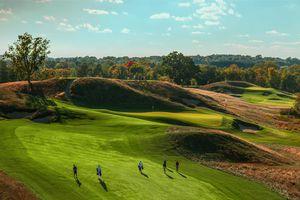 Golfers walking up the fairway at Erin Hills golf course