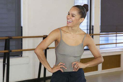 Ballerina Misty Copeland laughing in casual wear inside a ballet studio