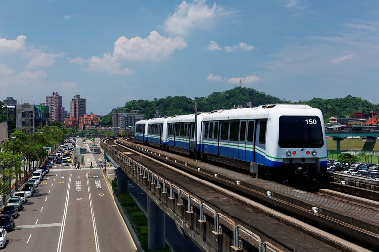 train traveling on elevated rails of Taipei Metro System