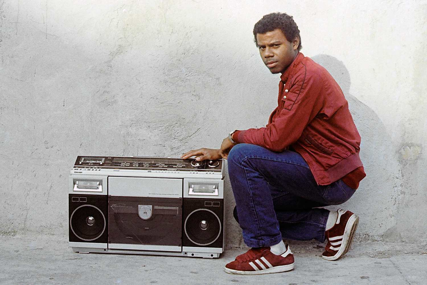 Tom the Great beside a boombox