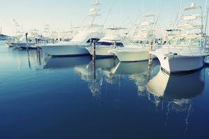 Yachts docked at a harbor