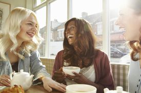 Women having coffee together in cafe