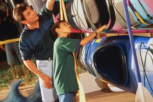 Father and son shopping for kayaks