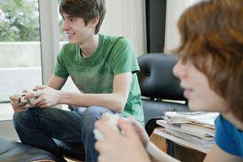 Teenage boys playing video games