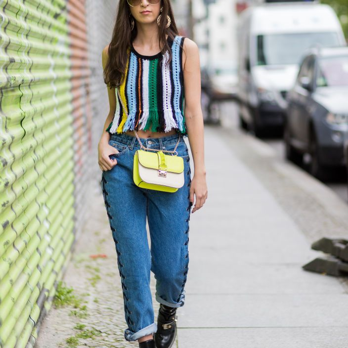 Street style fashion woman in striped top and jeans