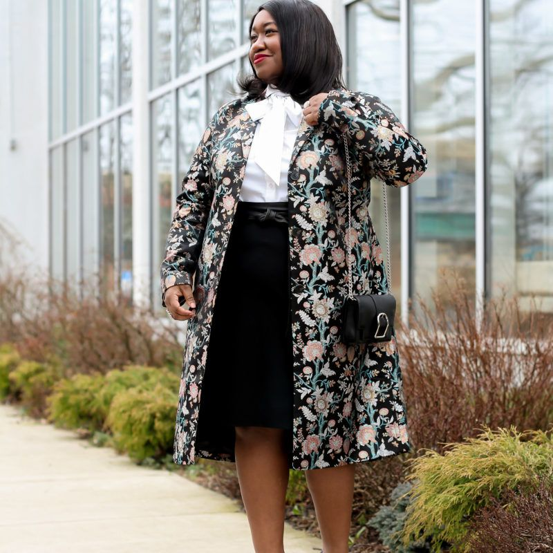 Woman in floral skirt and sophisticated outfit for the office