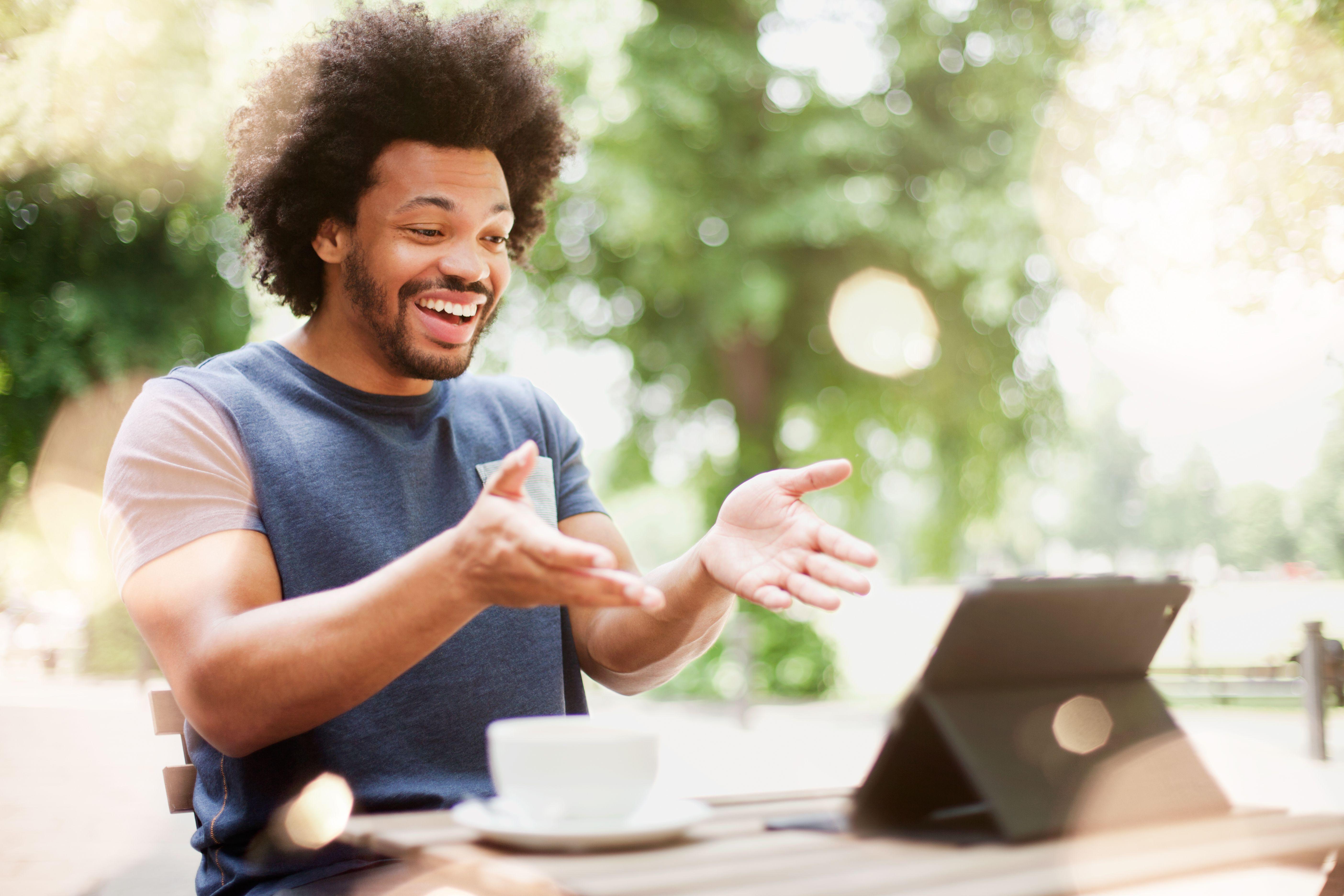 Man responding to screen of digital tablet.