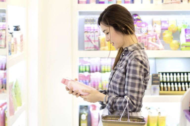 young woman shopping for shampoo