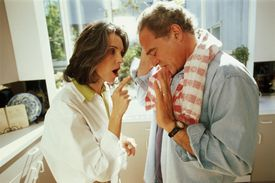 Mature couple in kitchen, arguing