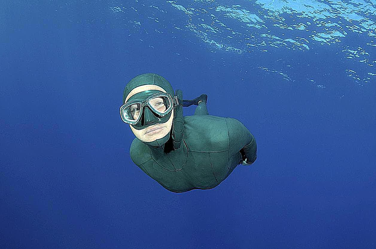 a person freediving underwater
