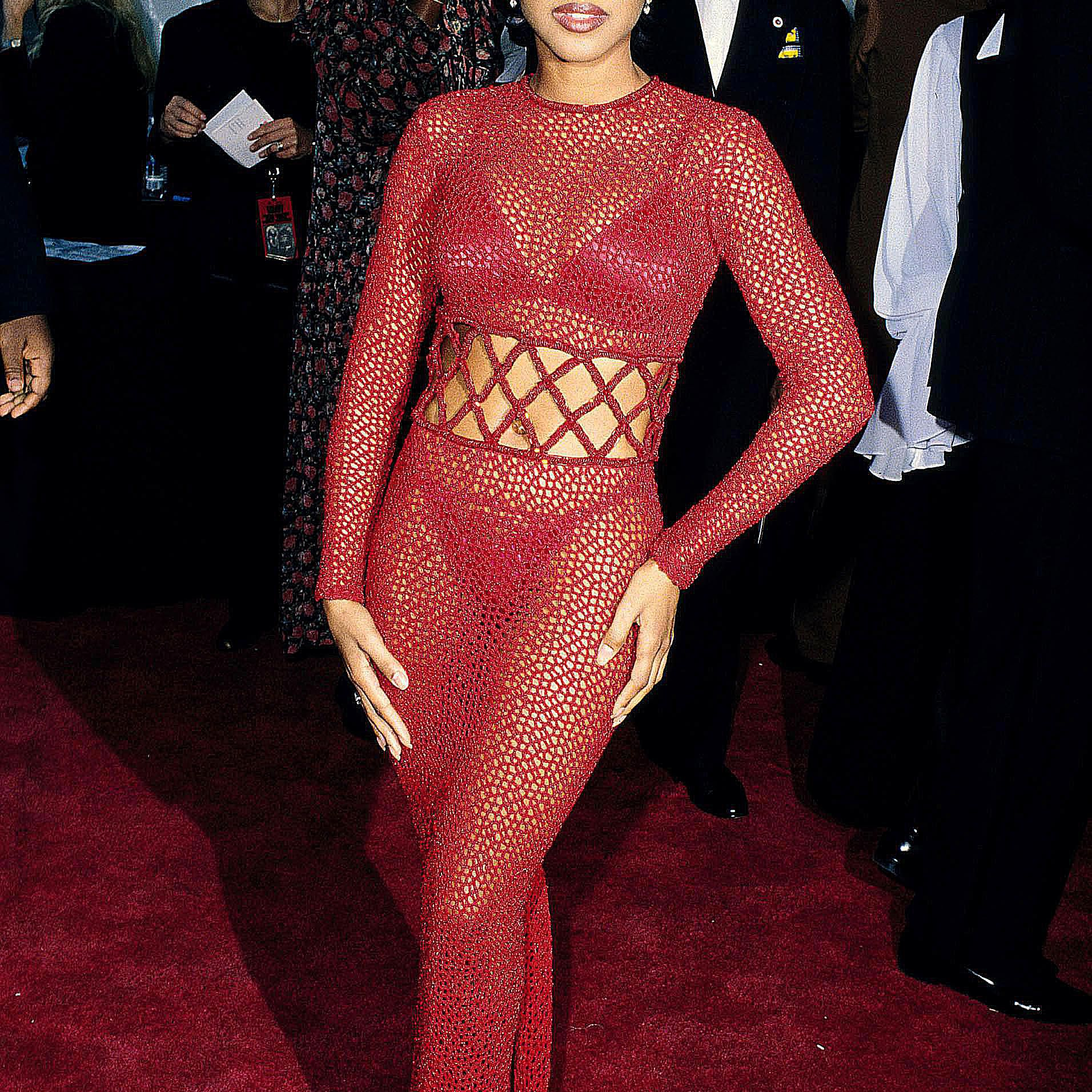 Toni Braxton wearing a pink mesh outfit on the red carpet