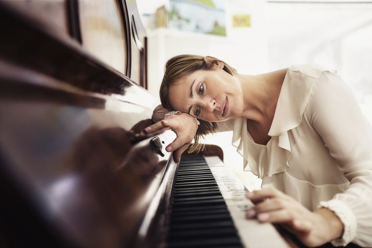 Relaxed woman at the piano