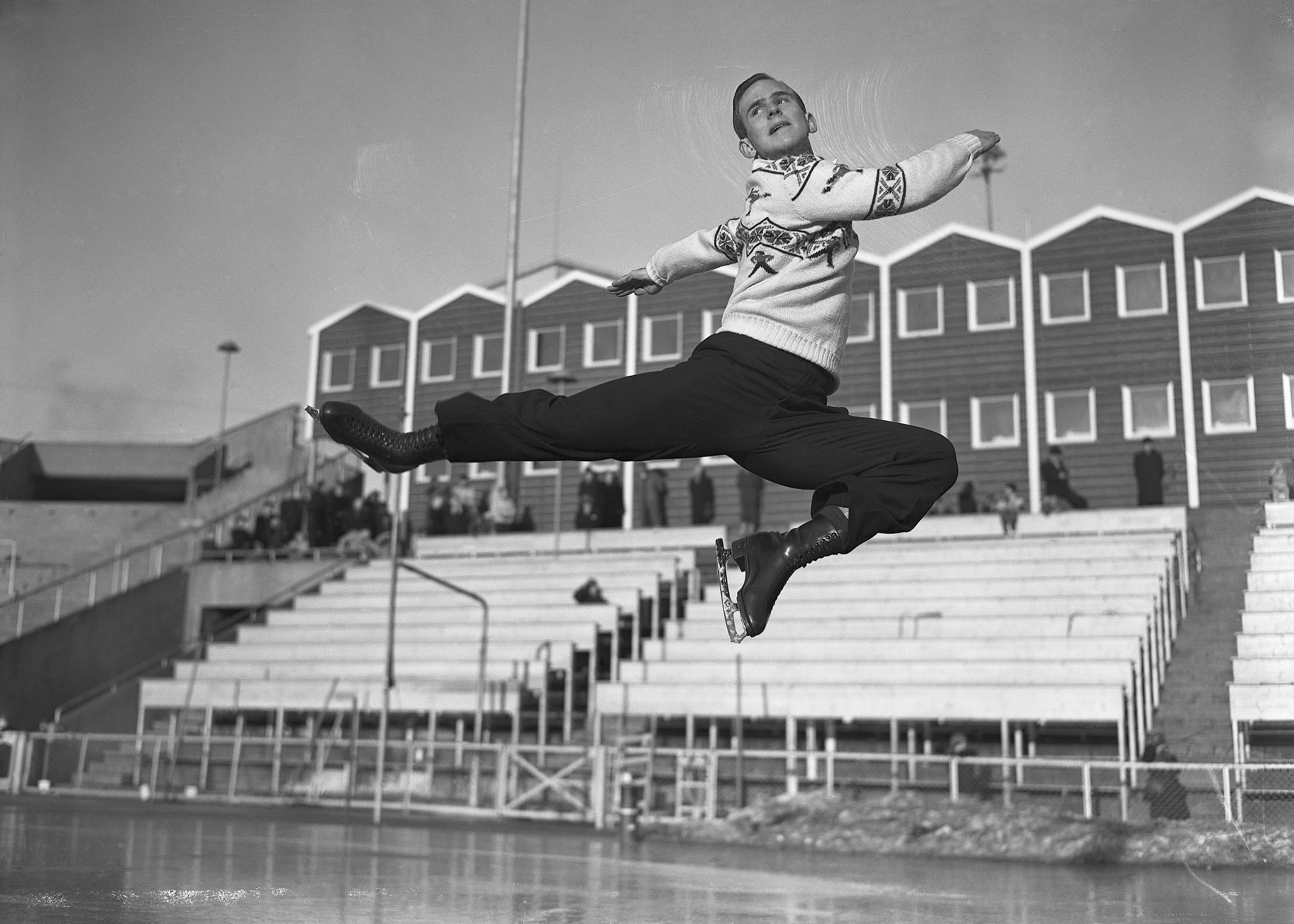 Figure Skater Dick Button Performing Jump