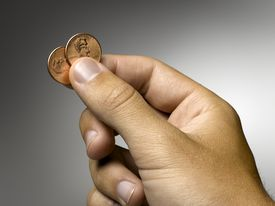 Man holding two pennies.