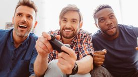 Three men playing Sony's PlayStation 4 video game console
