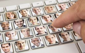Keyboard with online dating pictures on each key.