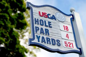 The 18th hole yardage sign for the 2013 US Open at Merion Golf Club