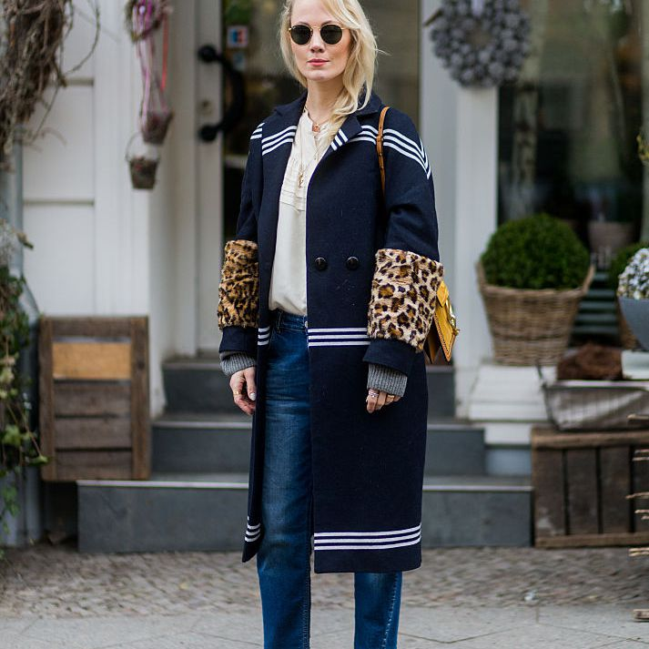 Street style woman in coat and jeans