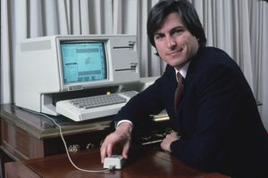 Apple computer Chrmn. Steve Jobs w. new LISA computer during press preview.