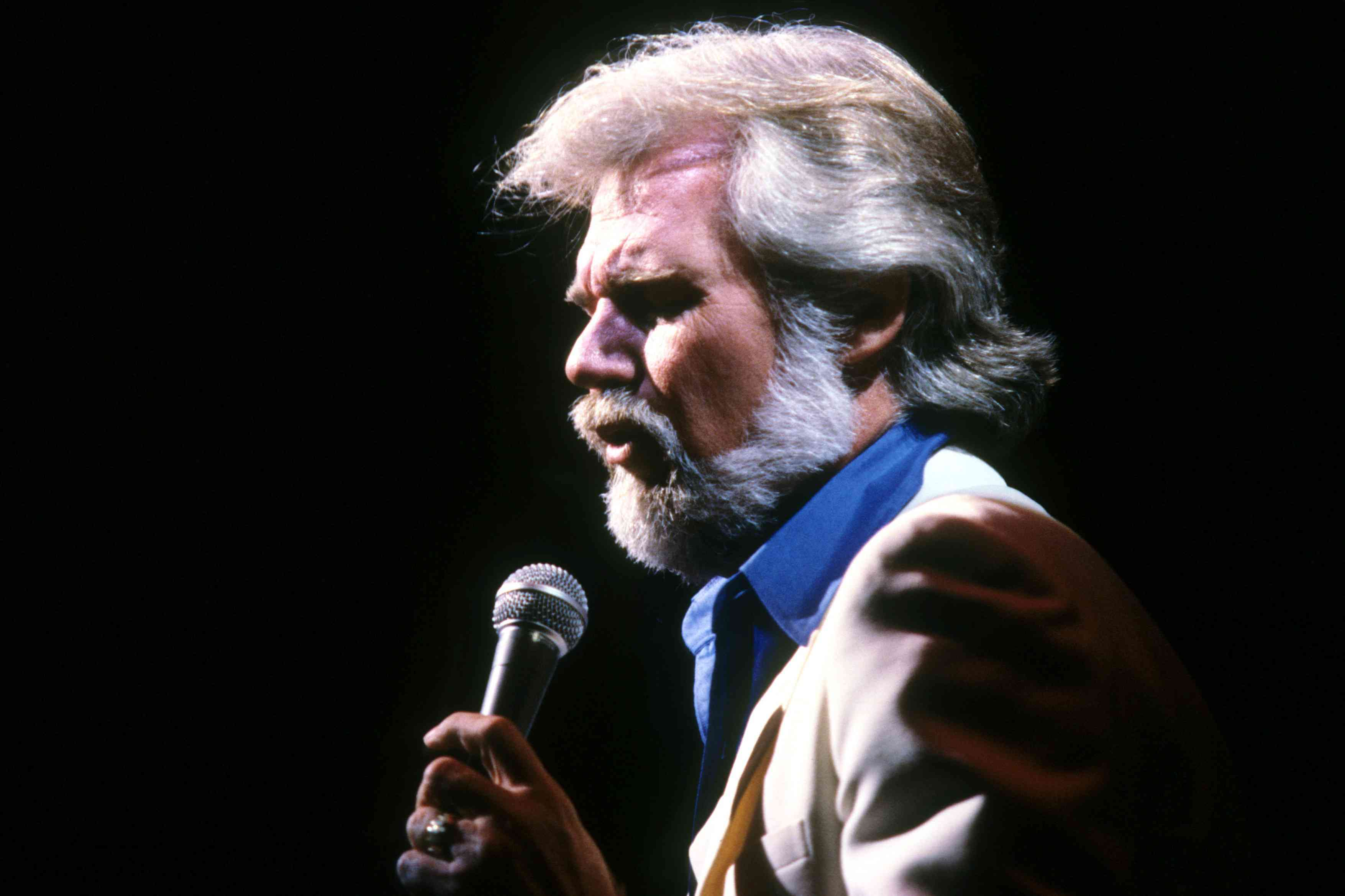 Country singer-songwriter Kenny Rogers croons onstage in New Jersey in 1982