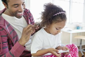 When is it safe to relax a child's hair?
