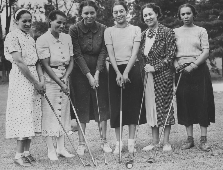A group of women holding golf clubs at the Wake-Robin golf club, an African-American women's golf club in Washington DC, on April 6, 1938.