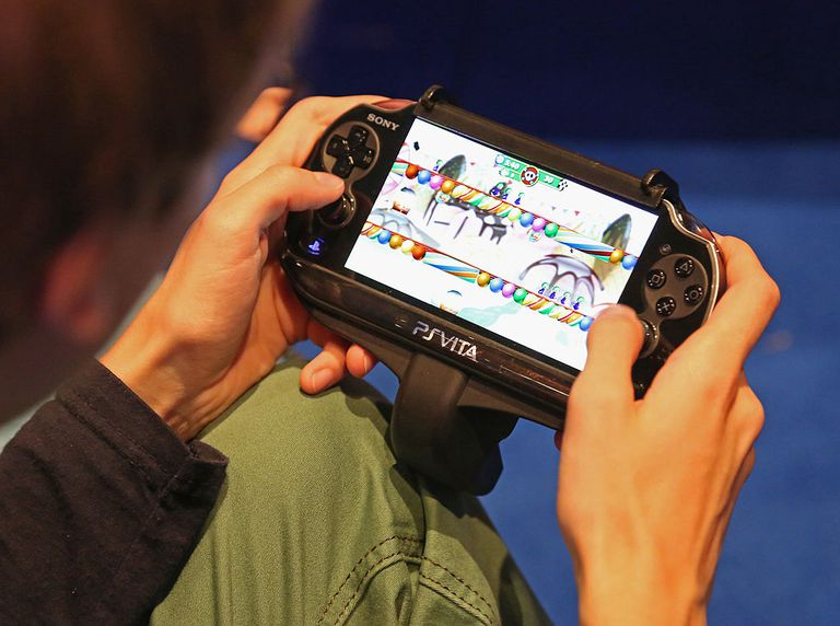 Playing a game on a Sony Playstation Vita, close-up