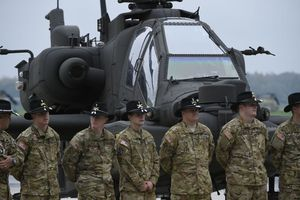 US Army soldiers standing in front of a helicopter at Illesheim.