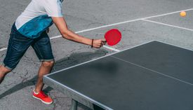 Low Section Of Man Playing Table Tennis