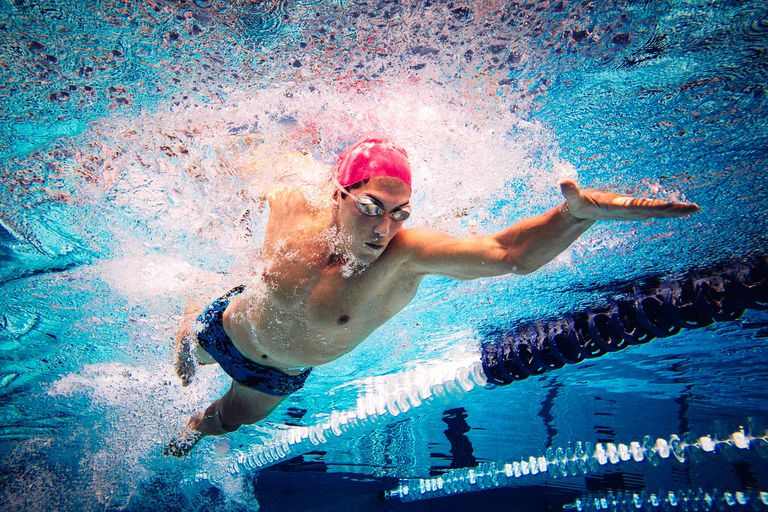 A man swimming freestyle