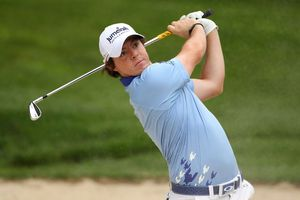 Rory McIlroy plays an iron approach during the 2011 US Open tournament.