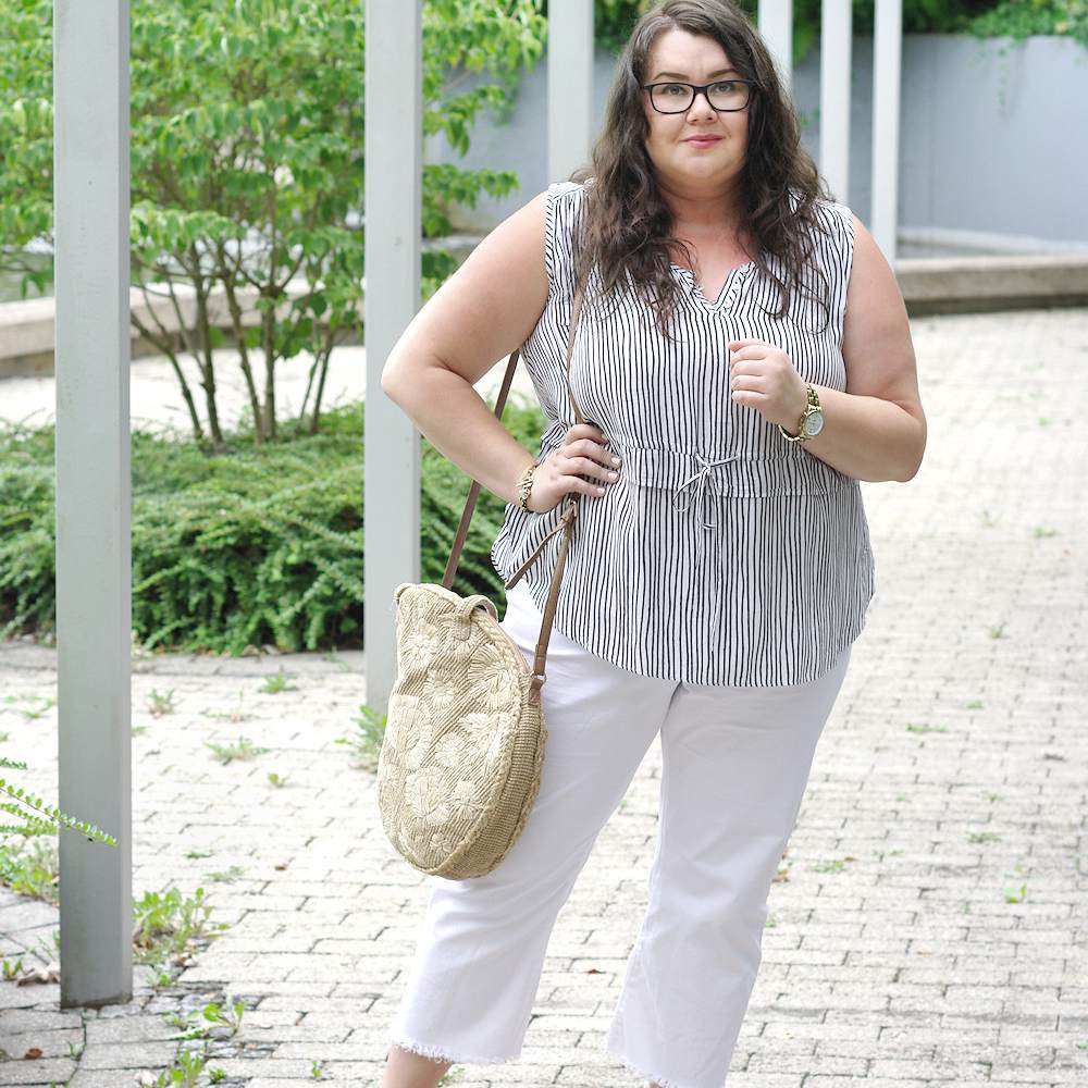 Woman in white pants and striped summer top