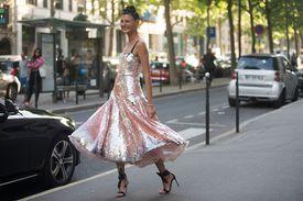 Giovanna Battaglia wears a pink Valentino couture dress after the Valentino show at Hotel Salomon de Rothschild