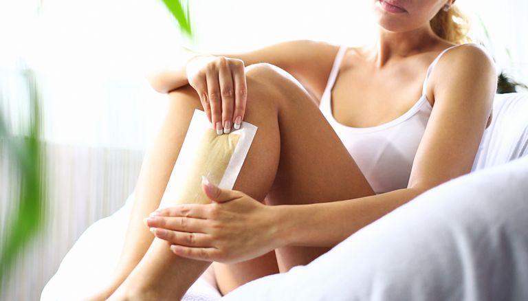 woman waxing her own leg