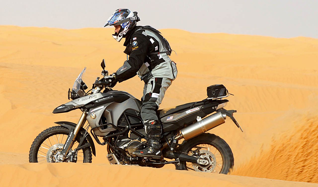 Man standing up on a dirtbike