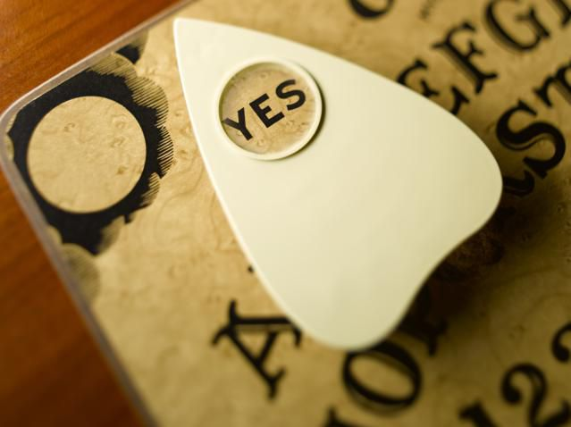 Closeup of a planchette on a Ouija board