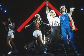 Asia perform on stage in London, 1983, left to right: Carl Palmer, Geoff Downes, John Wetton, Steve Howe.