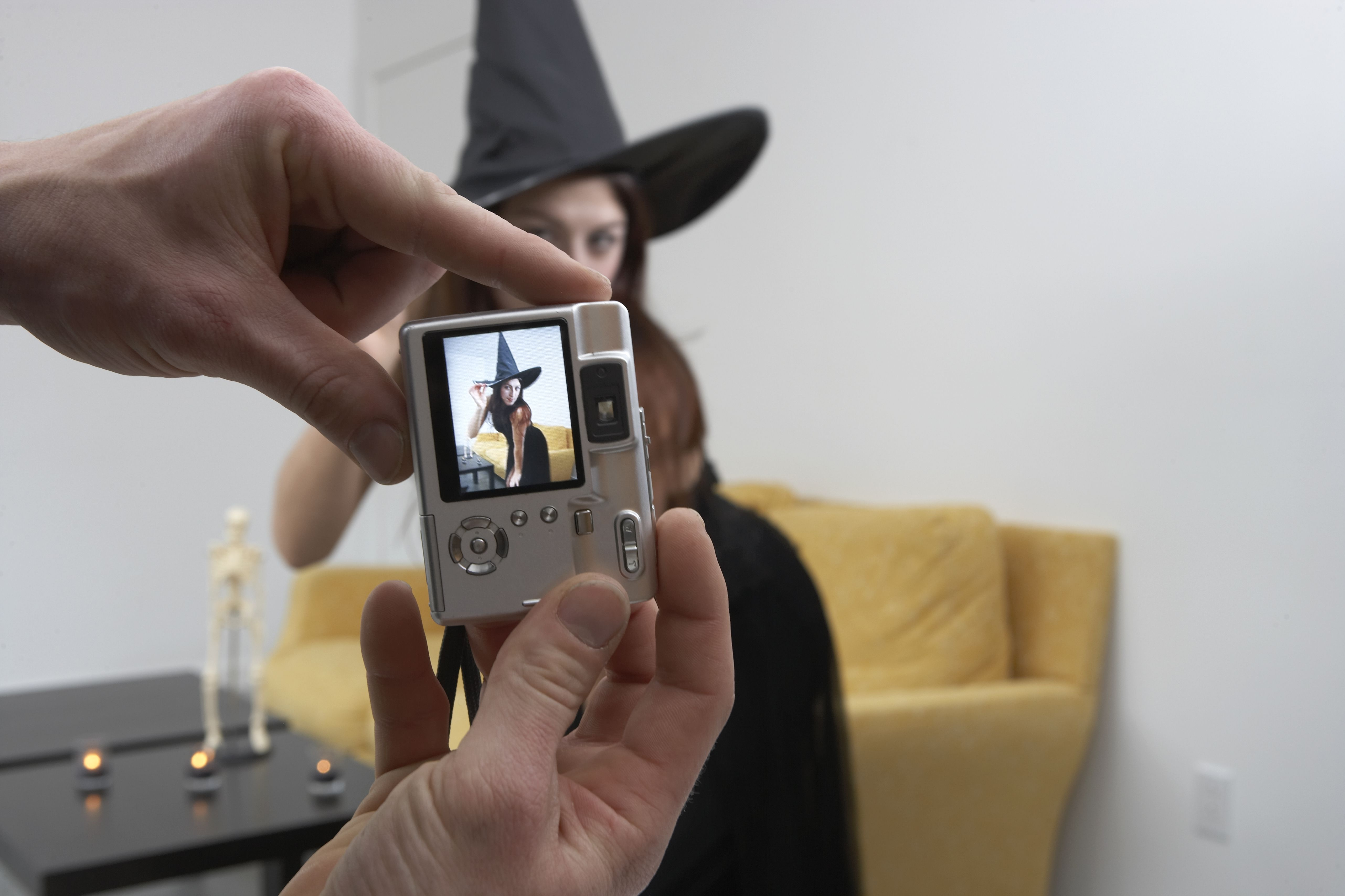 Person Taking a Halloween Costume Contest Photo