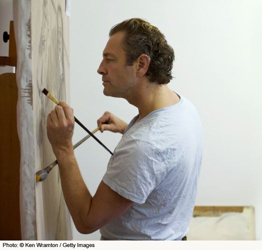 Artist using a mahl stick