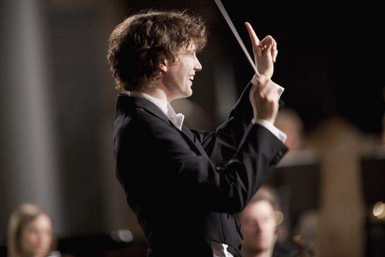 A conductor leading an orchestra