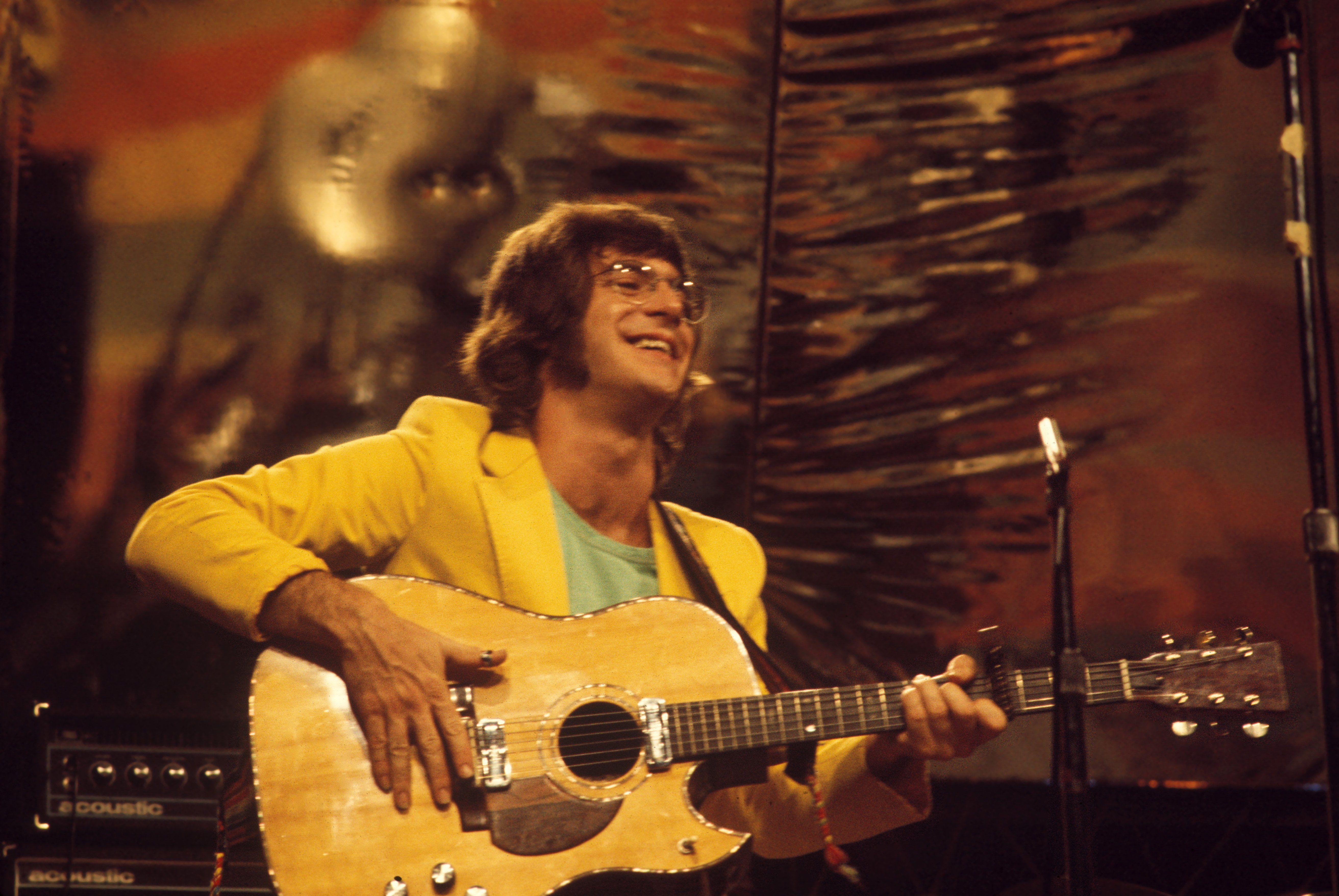 John Sebastian playing acoustic guitar live