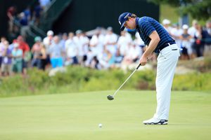 Hudson Swafford putts on the 18th green during the second round of the 2016 Deutsche Bank Championship