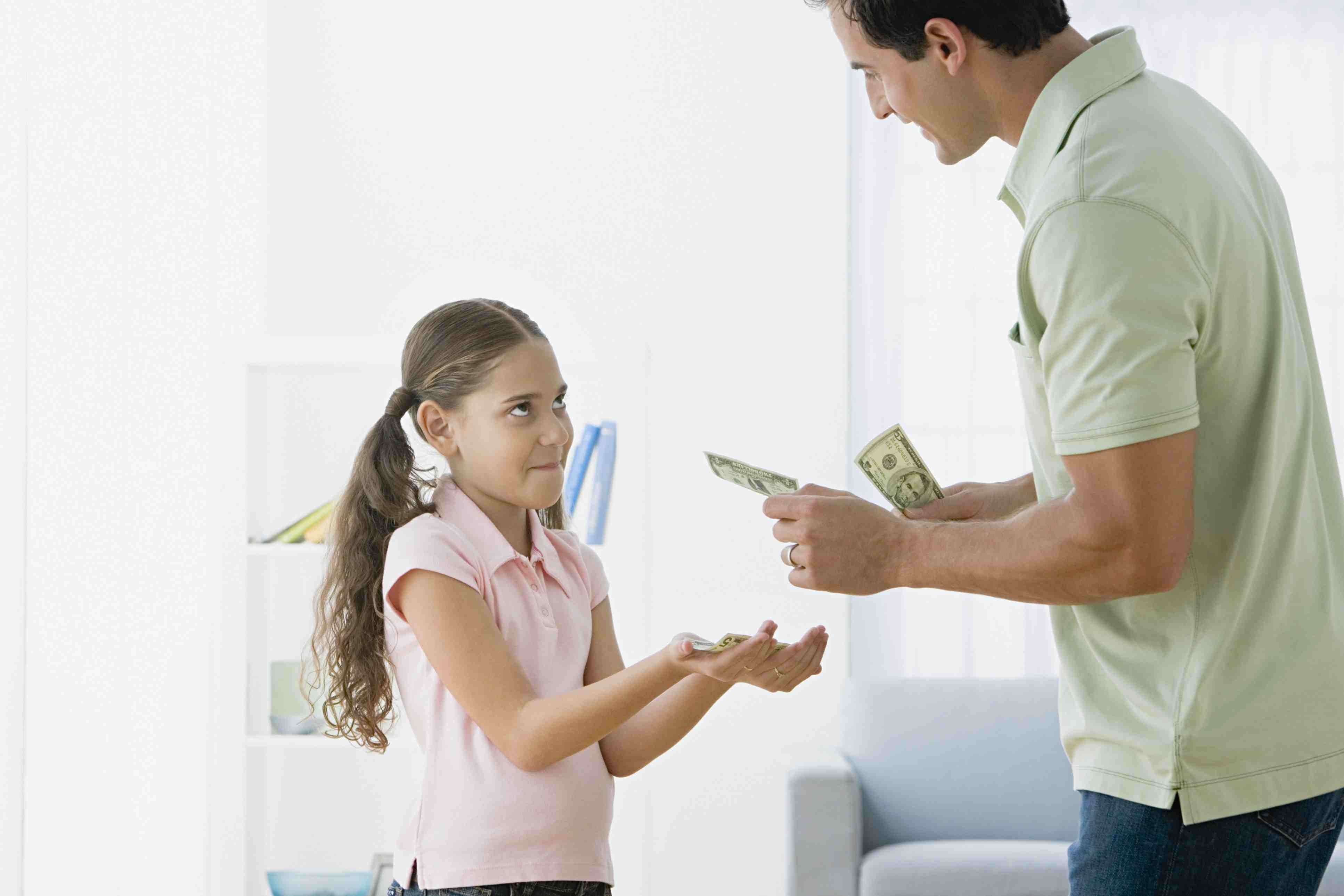 affluenza - girl getting allowance from dad
