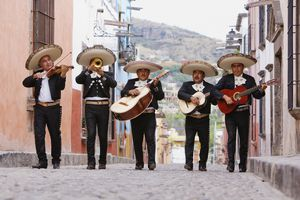 Mexican mariachi band walking in street