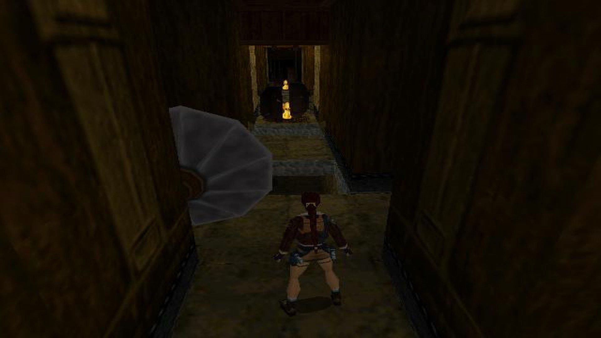 Lara Croft approaches a hallway trap in Tomb Raider II
