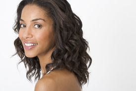 Opting for waves over straight hair can make your tresses appear fuller.