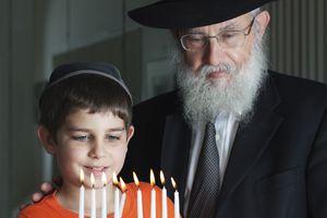 Lighting the Menorah a Jewish grandfather may be called zayde
