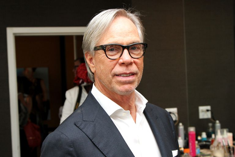 Tommy Hilfiger strikes a pose backstage at fashion week