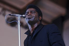 James brown standing in front of a microphone