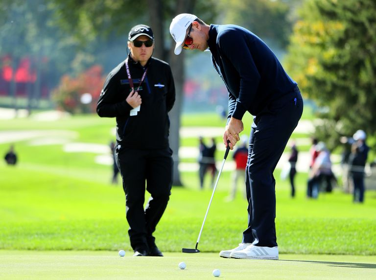 PGA Tour golfer Justin Rose practices his putting